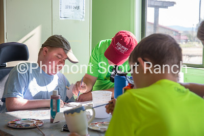 A father and his son are working together to paint ceramics at the Philmont Training Center craft center at Philmont Scout Ranch in Cimarron, New Mexico on Monday, July 29. 2019.