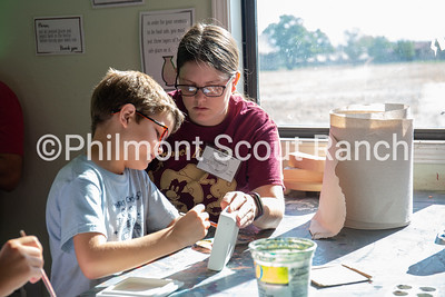 Kerri Thompson helps her son paint a ceramic box at the Philmont Training Center craft center at Philmont Scout Ranch in Cimarron, New Mexico on Monday, July 29. 2019.