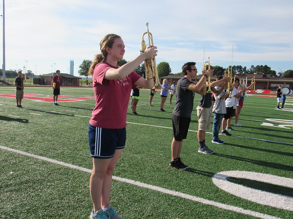 Staff photo by Cathy Spaulding<br /> Fort Gibson High School band members hold their trumpets firmly in front of their heads during morning drills. The band will march to a complex beat this season.