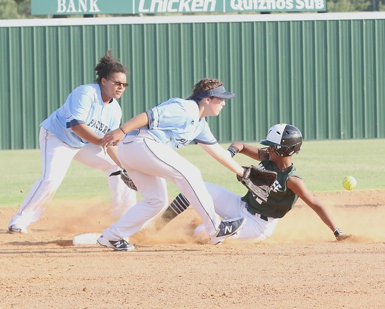 Phoenix special photo by John Hasler<br /> Muskogee's Jordan Simmons, right, steals second on late throw to Enid's Hadee Dent, center, during the Lady Roughers' win on Monday.
