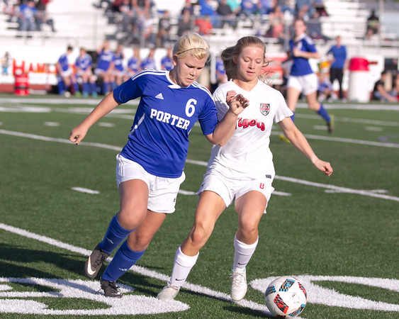 Phoenix special photo by Abigail Washington<br /> Porter's Kailey Miesner, left, and Fort Gibson's Katie McCroskey battle for possession during Friday's game at Leo Donahue Tiger Stadium.