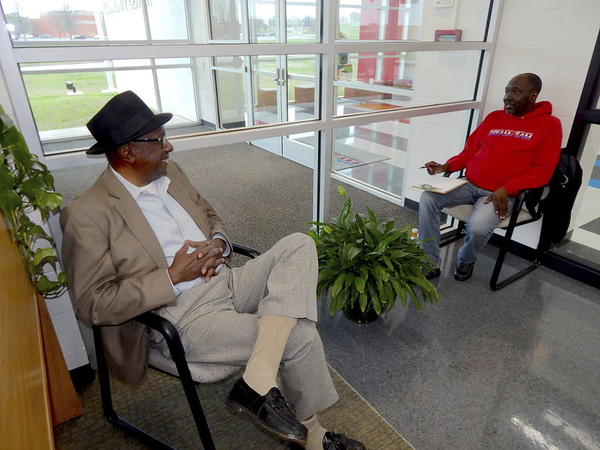 D.E. SMOOT/Muskogee Phoenix<br /> Cedric Johnson, left, discusses with Derrick Reed, director of the Dr. Martin Luther King Jr. Community Center, the planned walkout by Oklahoma teachers after state lawmakers pass — and the governor signed — a bill that falls short of their funding demands for public education.