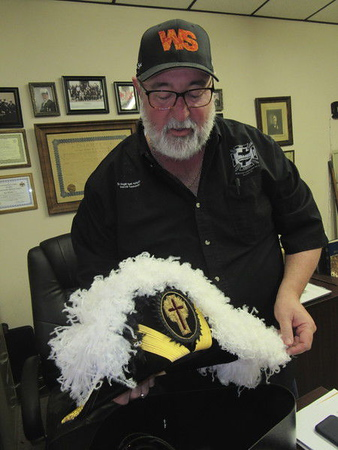 "CATHY SPAULDING/Muskogee Phoenix<br /> Mark McFadden handles the elaborate ""chapeau"" he wears for Knights Templar occasions. He said the Knights Templar are part of the York Rite Masons."