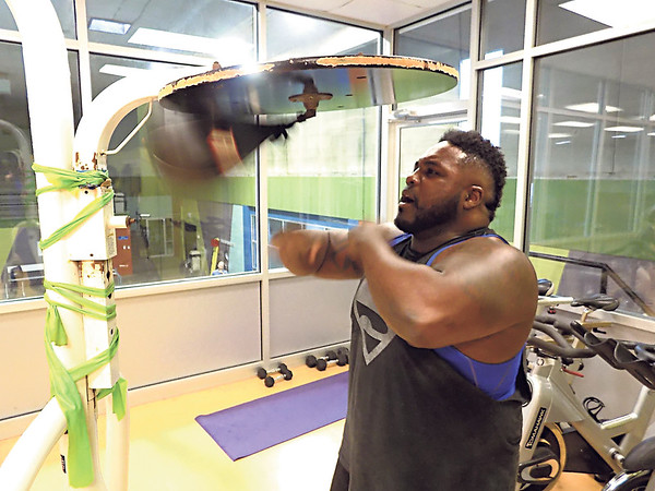 MIKE ELSWICK/Muskogee Phoenix<br /> Several boxing stations make up part of the circuit for cardio boxing sessions led by fitness instructor Clint Thomas at the City of Muskogee Swim and Fitness Center.