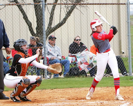 JOHN HASLER/Phoenix special photo<br /> Fort Gibson's Maddi Jo Williams cranks out her second home run of game one, a grand slam, as the Lady Tigers swept the doubleheader from Tahlequah 28-19 and 12-2.