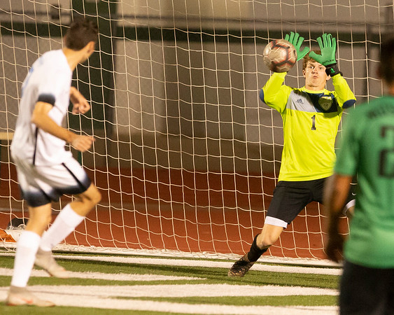 VON CASTOR/Special to the Phoenix<br /> Muskogee goalkeeper Jacob Scheihing makes a save against Bartlesville late in the game Tuesday night at Indian Bowl.
