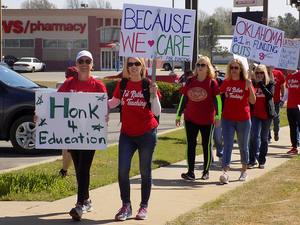 MIKE ELSWICK/Muskogee Phoenix<br /> Rallying teachers and students from Creek and Tony Goetz elementary school campuses marching to the Muskogee Civic Center for a noon rally met at the intersection of York<br /> Street and Chandler Avenue as they headed downtown.