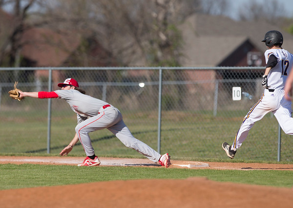 VON CASTOR/Phoenix special photo<br /> Fort Gibson first baseman Andrew Rumbley stretches to get the put out on Red Oak's Will Stacey Tuesday afternoon at Fort Gibson