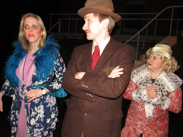 "CATHY SPAULDING/Muskogee Phoenix<br /> Orphanage owner Miss Hannigan (Juliet Burk, left) hatches a dastardly<br /> plot with her brother Rooster (Braden Thomson) and his girlfriend (Chrissy Thomson) in a scene from the Muskogee Little Theatre production ""Annie."""