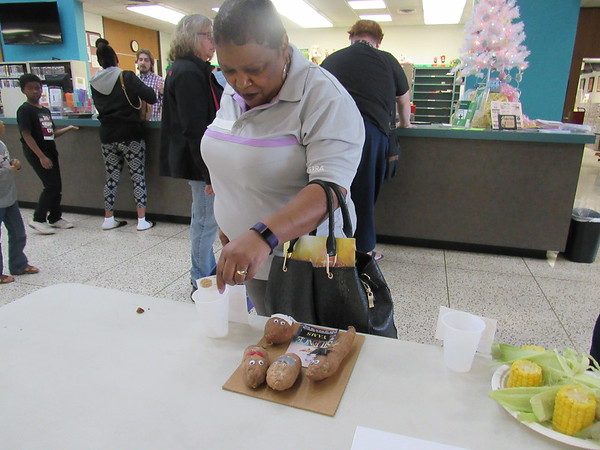 Alesia Kayhill votes for her favorite culinary depiction of a book Thursday at Muskogee Public Library.