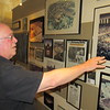 CATHY SPAULDING/Muskogee Phoenix<br /> Architect Mike Martin shows some of the projects he's designed over nearly 50 years at the drafting table. They include schools, gymnasiums and courthouses.