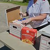 CHESLEY OXENDINE/Muskogee Phoenix<br /> Salvation Army Lt. Teri Smith checks on food available to those in need Friday morning. Lake Area United Way donated $5,000 to the Salvation Army on Wednesday from a fund dedicated to aiding with the impact of COVID-19.