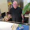 CATHY SPAULDING/Muskogee Phoenix<br /> Architect Mike Martin uses the same drafting table his mentor, Charlie Cook, used nearly 50 years ago. He said he prefers using the table to designing on computers.