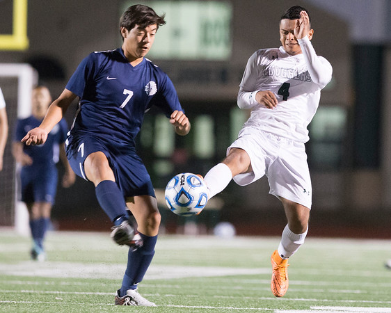 Phoenix special photo by Von Castor<br /> Muskogee's Carlos Martinez, right, and Enid's Jose<br /> Neri battle for a loose ball during Tuesday's match.