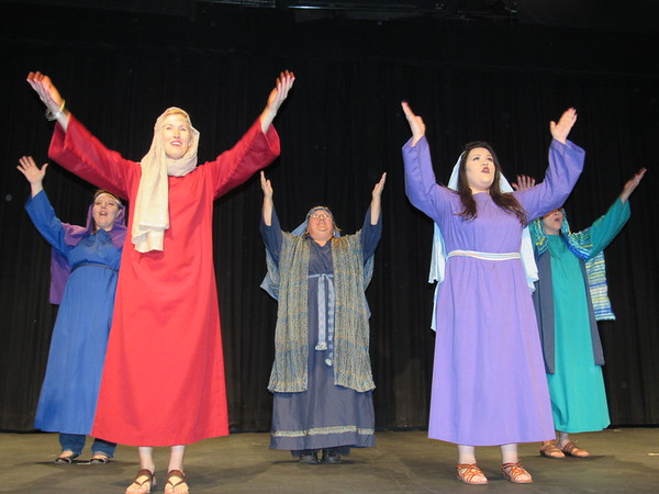 """Staff photo by Cathy Spaulding<br /> Muskogee First Assembly of God performers raise hands in praise during the Easter musical, """"The Choice."""""""