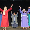 "Staff photo by Cathy Spaulding<br /> Muskogee First Assembly of God performers raise hands in praise during the Easter musical, ""The Choice."""
