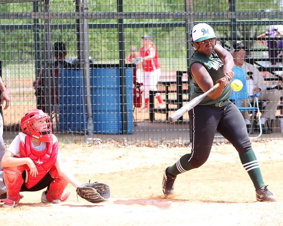 Phoenix special photo by John Hasler<br /> Muskogee's Elexis Watson homers against Stilwell in the Sequoyah Spring Classic.