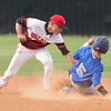 Phoenix special photo by Von Castor<br /> Hilldale shortstop Dalton Folsom tags out a Sapulpa baserunner trying to steal second Thursday afternoon at Hornet Field.
