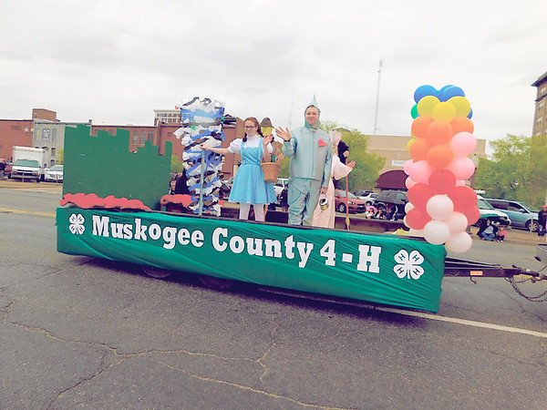 """KENTON BROOKS/Muskogee Phoenix<br /> Members of Muskogee County 4-H show off their favorite movie, """"The Wizard of Oz"""" during the rain-soaked and shortened Azalea Festival Parade Saturday. """"Movies to Remember"""" was the theme of this year's parade, and filmmakers Oscar and ShIronbutterfly Ray were the grand marshals."""
