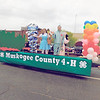 "KENTON BROOKS/Muskogee Phoenix<br /> Members of Muskogee County 4-H show off their favorite movie, ""The Wizard of Oz"" during the rain-soaked and shortened Azalea Festival Parade Saturday. ""Movies to Remember"" was the theme of this year's parade, and filmmakers Oscar and ShIronbutterfly Ray were the grand marshals."