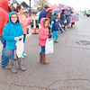 KENTON BROOKS/Muskogee Phoenix<br /> Haley Wheeler, left, and her sister Taylor Wheeler get ready to scoop up candy on Okmulgee Avenue as it was thrown by participants in Saturday's Azalea Festival Parade.