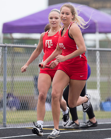 Phoenix special photo by Von Castor<br /> Fort Gibson's Carlee Fryar, left, hands off to Cailey Cunningham in the 400-meter relay during Friday's track meet in Checotah.