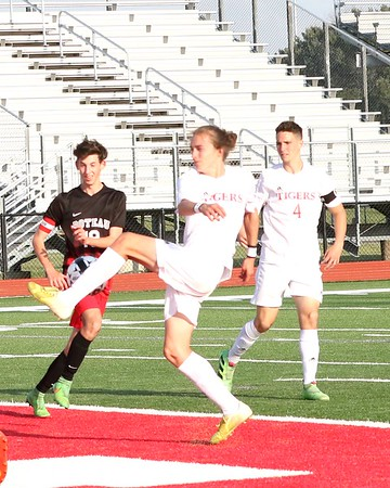 Phoenix special photo by John Hasler<br /> Fort Gibson's Colby Leonard, center, gains control of the ball as teammate Cade Cummings, right, and Poteau's Bryce Anderson watch during Friday's match at Leo Donahue Tiger Stadium. The Tigers won 7-0.