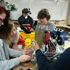 Staff photo by Wendy Burton<br /> Muskogee High School Rougher Robo Royalty robotics team members Karen Craig, left, Julia Kent, Lee Triplett, Duston Schesny and Eric Harrison work on the robot they will be taken to the FIRST Championships competition next week — where they will compete against teams from more than 50 other countries for the world championship.