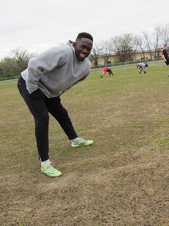 Cathy Spaulding/Muskogee Phoenix<br /> Tobi Oganla warms up before Bacone College soccer practice. He came to the United States on a Bacone soccer scholarship and now helps coach the team.