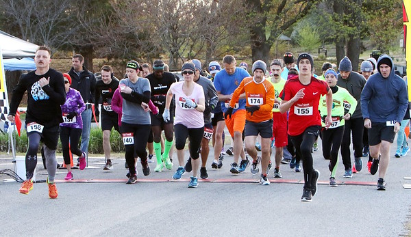 JOHN HASLER/Phoenix Special Photo<br /> Runners begin the 15K Muskogee Run on Saturday at Honor Heights Park.
