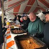 CHESLEY OXENDINE/Phoenix special photo<br /> Representatives of Advanced Workzone Services serve up pulled pork, hot links and beans to visitors during Saturday's event.