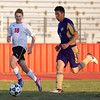 Phoenix special photo by Shane Keeter<br /> Hilldale's Latham Weaver, left, and Heavener's Victor Ortega give chase to a loose ball during the match on Friday at Hilldale High School.