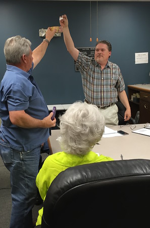 Staff photo by D.E. Smoot<br /> Muskogee County Election Board Secretary Kelly Beach, right, draws Bobby Jefferson's name from a box, determining the winner of the April 5 runoff election for Office 1 of the Muskogee Board of Education.