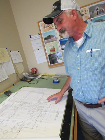 Staff photo by Cathy Spaulding<br /> Mike Williams hand-drafts plans for his homes and businesses. He said his father taught drafting and construction.