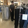 CHESLEY OXENDINE/Muskogee Phoenix<br /> Trenton Elkins shops for gently used clothes at the newly renovated Salvation Army Family Store on Monday morning.