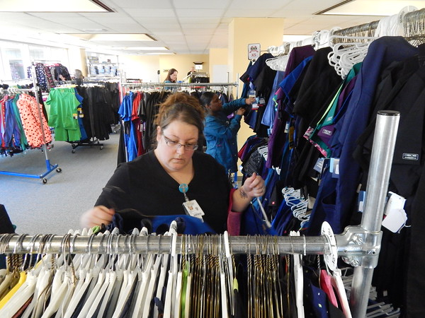 Staff photo by Mark Hughes<br /> Carly Thompson and Krystle Buffington, respiratory therapists, browse through outfits on display at EASTAR Health System's shop, which is staffed by volunteers.