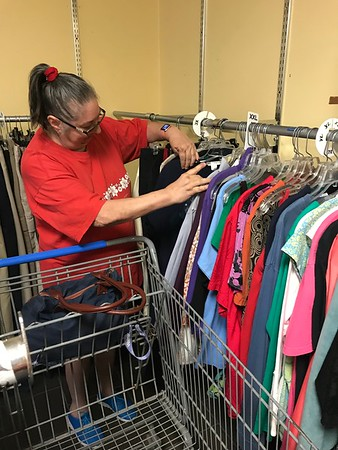 ANDREA CHANCELLOR/Special to the Phoenix<br /> A customer shops the bargain rack at Next2New Resale & Consignment.