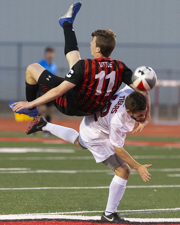 VON CASTOR/Special to the Phoenix Hilldale's Eli Little and Fort Gibson's Cade Gorham collide as they both battle for a header Tuesday night.