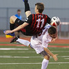 VON CASTOR/Special to the Phoenix<br /> Hilldale's Eli Little and Fort Gibson's Cade Gorham collide as they both battle for a header Tuesday night.