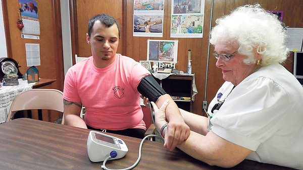 Staff photo by Wendy Burton<br /> Wesley Petterson of Muskogee has his blood pressure checked by Faith Community Nurse Catherine White at Central Baptist Church. Petterson, who is participating in a research study, said his blood pressure has been good most of the time.