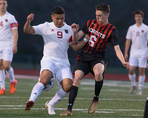 VON CASTOR/Phoenix special photo<br /> Fort Gibson's Marcus Estrada and Hilldale's Max James battle for possession. Fort Gibson took command in the district with a 3-0 win.