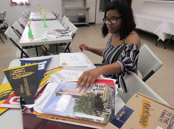 CATHY SPAULDING/Muskogee Phoenix<br /> Muskogee High School senior Raylynn Thompson sorts through some of her 64 college offers. She is ranked at the top of the class of 2019.