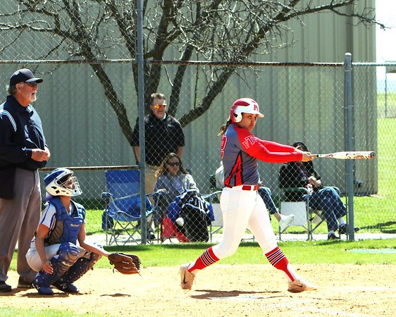 JOHN HASLER/Phoenix Special Photo<br /> Fort Gibson's Aubree Bell connects on what would be a grand slam home run in the second inning of Wednesday's Class 5A district tournament championship. Bell drove in nine runs in the contest, won by the Tigers over Checotah, 19-9.