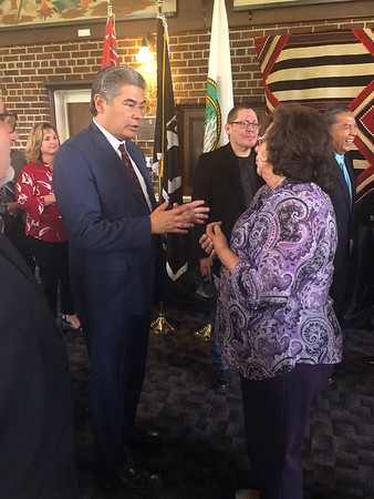CHESLEY OXENDINE/Muskogee Phoenix Legal counsel for Bacone College Wilson Pipestem (left) chats with United Keetoowah Band Delaware District Council Representative Adalene Smith following the announcement that the UKB would charter Bacone as a tribal college.
