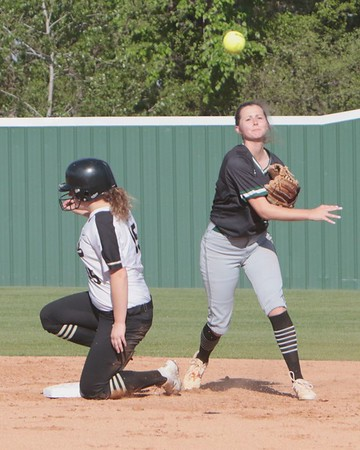 JOHN HASLER/Phoenix Special Photo<br /> Brookelyn Gilmore attempts to turn a double play against Broken Arrow on Thursday.