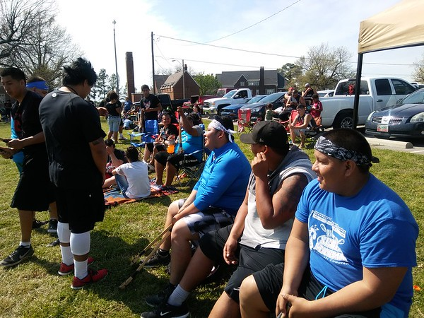 Staff photo by Wendy Burton<br /> William McMillan, right, rests between games at the Bacone College Center for American Indians stickball tournament Saturday. The tournament was held during the inaugural River City Intertribal Celebration.