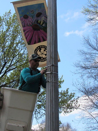 Tim Doerner hangs an Azalea Festival banner along Honor Heights Drive. Banners also can be found on Okmulgee Avenue and in Honor Heights Park.