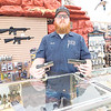 KENTON BROOKS/Muskogee Phoenix<br /> Chris Rankin, owner of R & R Gun and Pawn, talks about the 9 mm guns that have been the best seller since the threat of coronavirus began two weeks ago. Rankin said he was busy selling the guns and ammunition two weeks ago, but the number of customers has dropped off considerably.