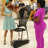 "Staff photo by Harrison Grimwood<br /> Pin-ups for Veterans model Valentina ""CiCi"" Cahill, left, plays her violin for a group of veterans during her visit to the Jack C. Montgomery VA Medical Center."