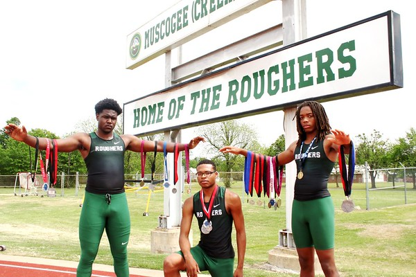 Phoenix special photo by John Hasler<br /> From left, thrower Mike Edwards and middle distance runner Jordan Escoe and sprinter John Smith have shined for Muskogee. The Roughers' next event is scheduled for Friday at Indian Bowl.